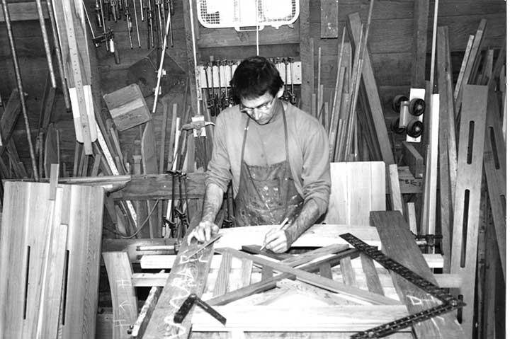 Early shop photo showing charles building the original wood garden gate #51.