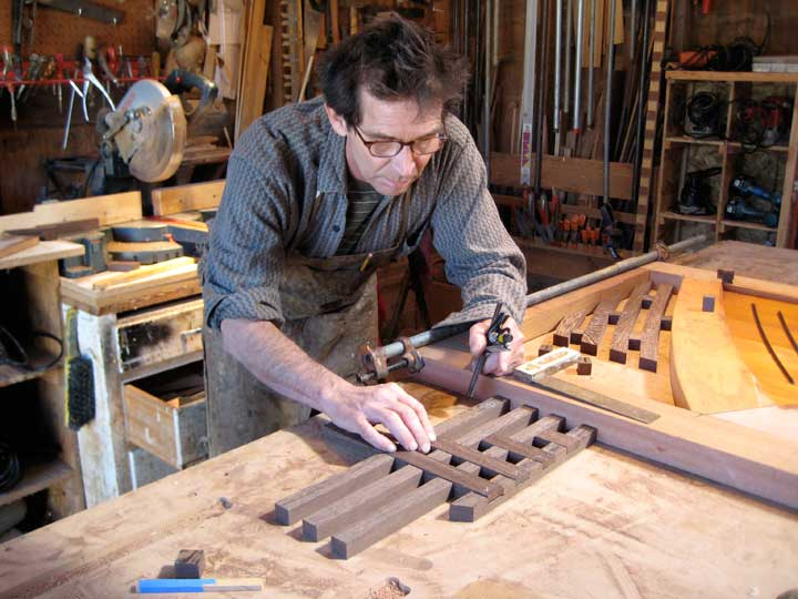 shop phptpgraph showing Charles laying out the wenge grrid for the modern gate 202