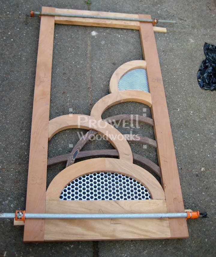 photograph showing the progress of the unusual wood gate #203