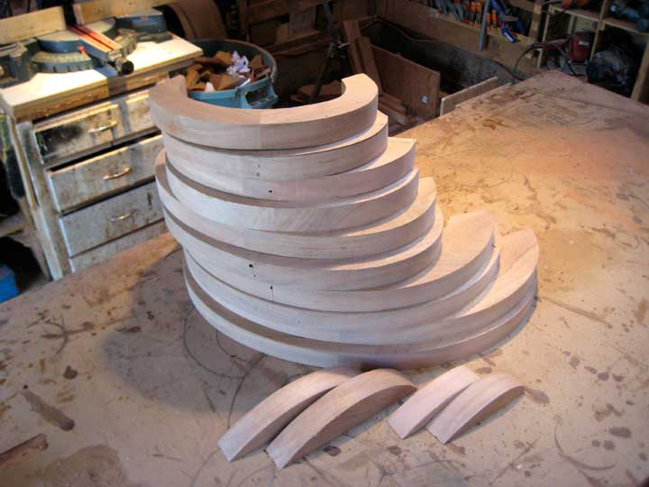 Shop photograph showing the completed wood ovals for the modern wooden gate design #203