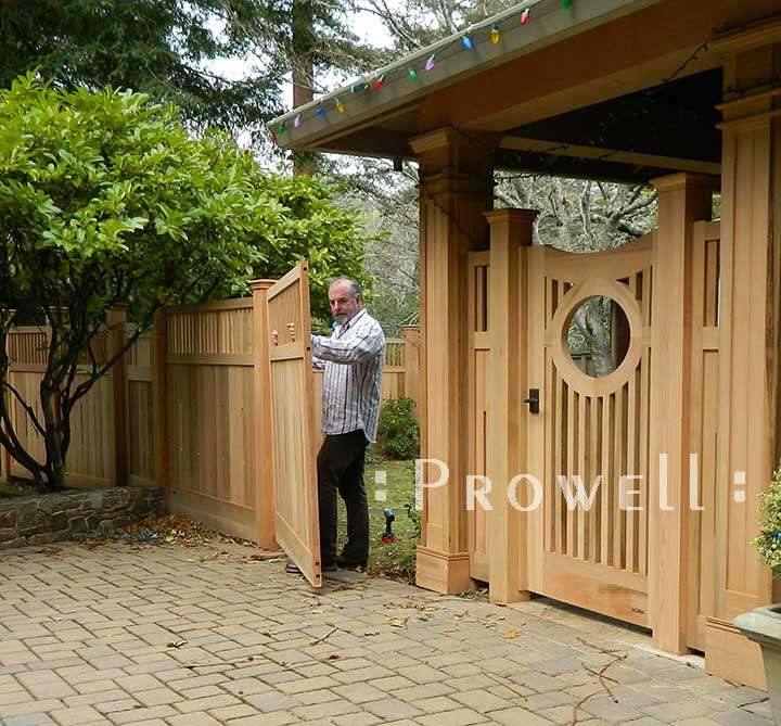 Brian Van Rheenan installing fence panels
