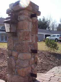 hanging driveway gates from stone