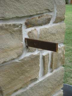How to support a drive gate off stone columns