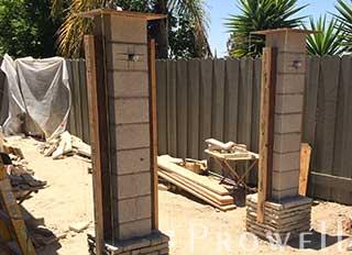 embedding wood jambs into stone gate columns