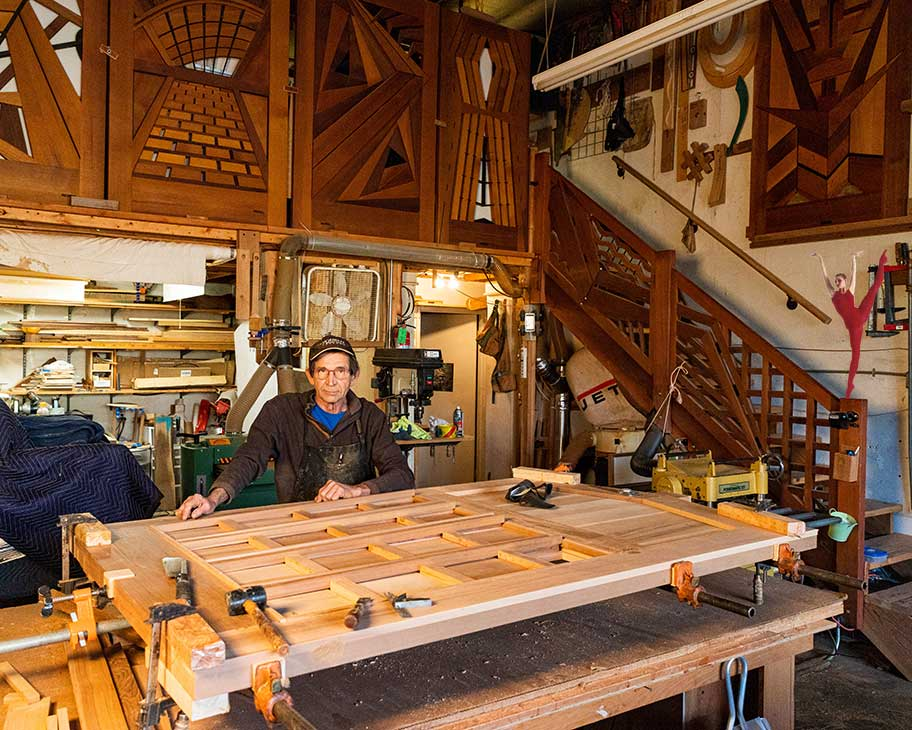 photo showing charles in the shop building the wood entrance gate #110 3110