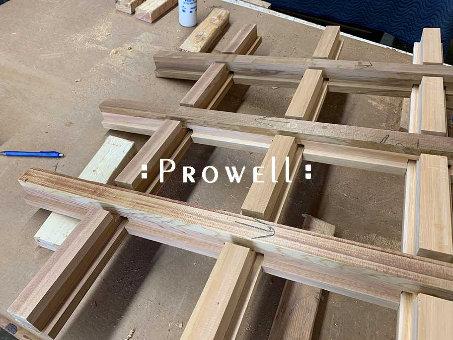 shop photograph showing the joinery for how to build the wooden gate entrance half-laps for #110