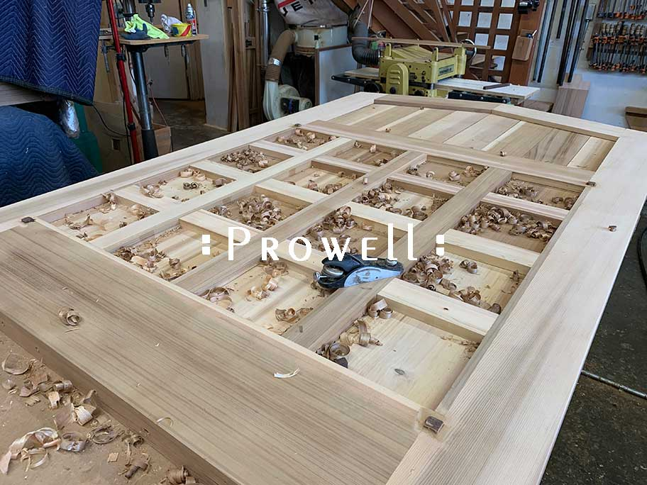 shop photo showing how to hand-plane the wooden entry gates #110